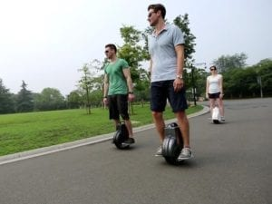 people enjoying electric unicycles