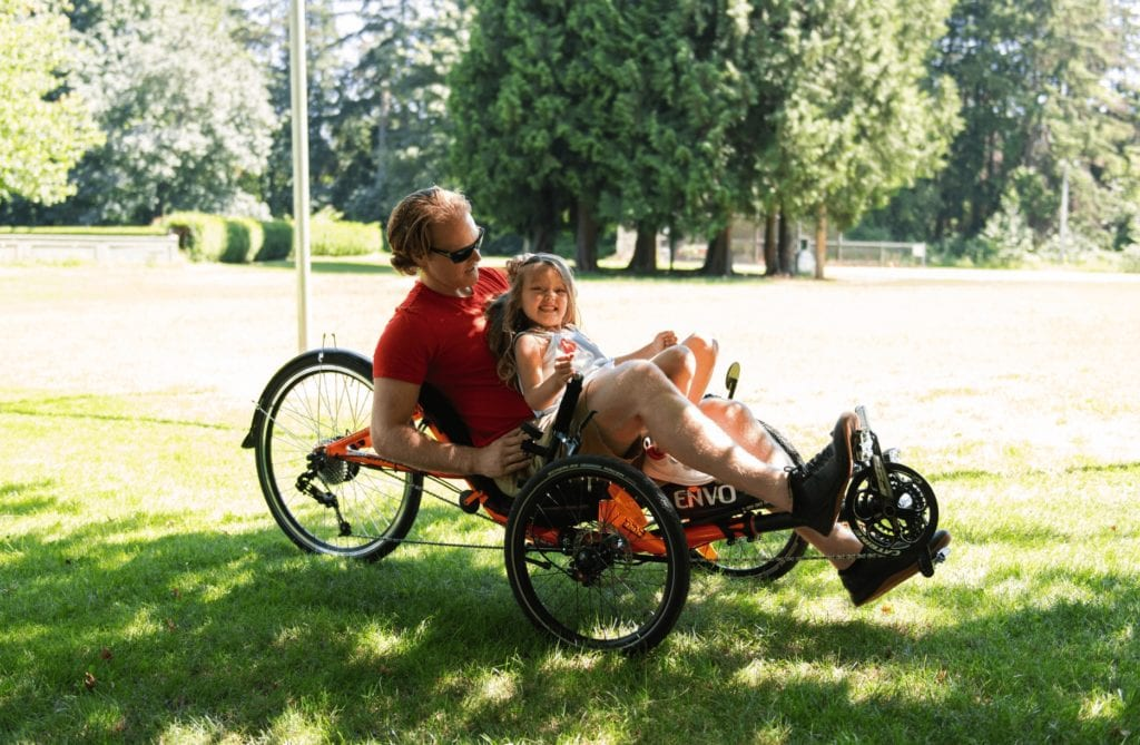 father daughter on electric trike